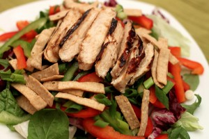 Warm Asian glazed chicken salad with ginger sesame dressing