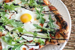 Grilled pizza with egg arugula and balsamic