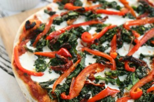 Grilled pizza with kale, roasted red peppers, and sundried tomatoes